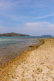Παραλία θάλασσας, μπλε ουρανός, άμμος, ήλιος, φως της ημέρας Στοκ Φωτογραφία