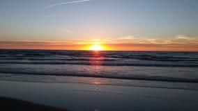 Παραλία Κάτω Χώρες ηλιοβασιλέματος Στοκ Εικόνες