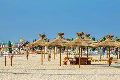 Παραλία ομπρελών καλάμων Στοκ Εικόνες