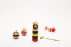 Παραδοσιακά ιαπωνικά παιχνίδια ` Darumaotoshi `, ` Kendama `, και ` Koma ` Στοκ Εικόνες