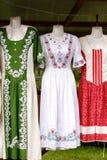Παραδοσιακά φορέματα με τις floral διακοσμήσεις Στοκ Εικόνα