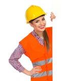 Παρουσίαση γυναικών εργατών οικοδομών Στοκ Εικόνες