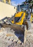 πασπαλίζοντας Εκσκαφέας στο εργοτάξιο οικοδομής στοκ φωτογραφία με δικαίωμα ελεύθερης χρήσης