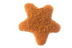 Πασπαλισμένο με ψίχουλα παιδιά αστέρι ψηγμάτων κοτόπουλου που διαμορφώνεται που απομονώνεται Στοκ εικόνα με δικαίωμα ελεύθερης χρήσης