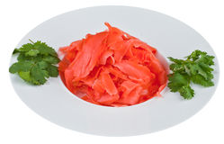 Παστωμένη πιπερόριζα στο άσπρο πιάτο Στοκ Εικόνα