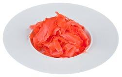 Παστωμένη πιπερόριζα στο άσπρο πιάτο Στοκ Φωτογραφίες