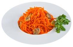 Παστωμένο καρότο στο άσπρο πιάτο Στοκ Εικόνες