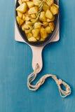 πατάτες που ψήνονται Στοκ φωτογραφία με δικαίωμα ελεύθερης χρήσης
