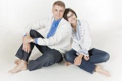 Πατέρας και κόρη που φορούν τα εθνικά ενδύματα Στοκ Εικόνες