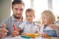 Πατέρας και σχεδιασμός παιδιών Στοκ Εικόνα