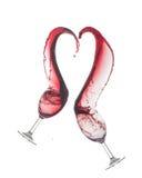 Παφλασμοί κρασιού με μορφή μιας καρδιάς Στοκ Εικόνες