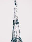 Παφλασμός μπουκαλιών νερό Στοκ Φωτογραφία