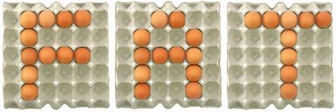 ΠΑΧΙΑ λέξη από τα αυγά στο δίσκο εγγράφου Στοκ φωτογραφία με δικαίωμα ελεύθερης χρήσης