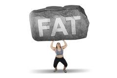 Παχύσαρκη ανυψωτική πέτρα γυναικών με την παχιά λέξη Στοκ εικόνες με δικαίωμα ελεύθερης χρήσης