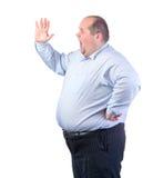 Παχύ άτομο σε ένα μπλε πουκάμισο, να φωνάξει Στοκ Εικόνες