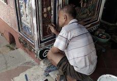 Παλαιά αφή ατόμων επάνω στη ζωγραφική χρώματος τοίχων ναών Cheng Hoon Teng Στοκ εικόνα με δικαίωμα ελεύθερης χρήσης