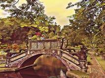 Παλαιά γέφυρα πετρών επάνω από τη λίμνη στο πάρκο Από το Μπαλί γλυπτική πετρών αρχιτεκτονικής Εκλεκτής ποιότητας πάρκο στο τροπικ Στοκ φωτογραφίες με δικαίωμα ελεύθερης χρήσης