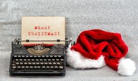 Παλαιά γραφομηχανών κόκκινη καπέλων εικόνα ύφους Χαρούμενα Χριστούγεννας αναδρομική Στοκ φωτογραφία με δικαίωμα ελεύθερης χρήσης