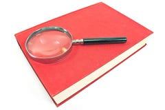 Παλαιά ενίσχυση - γυαλί στο κόκκινο βιβλίο Στοκ Φωτογραφίες