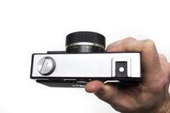 Παλαιά κάμερα ταινιών στα χέρια Στοκ Εικόνα
