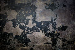 Παλαιά μαύρη αποφλοίωση σύστασης χρωμάτων από το υπόβαθρο συμπαγών τοίχων Στοκ Φωτογραφία