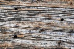 Παλαιά ξεπερασμένη ραγισμένη ξύλινη σύσταση επιφάνειας διασυνδετικών δοκών Στοκ Εικόνα