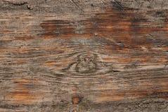 Παλαιά ξύλινη επιφάνεια με τα τσιπ πετρών Στοκ Εικόνες