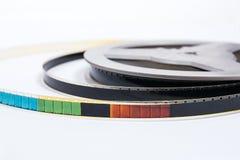 Παλαιά λουρίδα ταινιών κινηματογράφου στο άσπρο υπόβαθρο Στοκ Φωτογραφία
