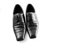 Παλαιά παπούτσια μαύρων στο άσπρο υπόβαθρο Στοκ Εικόνες