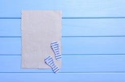 Παλαιά περγαμηνή και μπλε πίνακες Στοκ Φωτογραφίες