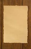 Παλαιά περγαμηνή στο ξύλο Στοκ φωτογραφία με δικαίωμα ελεύθερης χρήσης