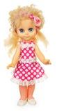Παλαιά πλαστική κούκλα στο ρόδινο φόρεμα Στοκ Φωτογραφία