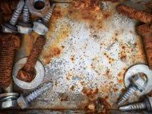 Παλαιά σκουριασμένα μπουλόνια, χάλυβας, καρύδια Στοκ Φωτογραφία