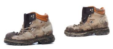 Παλαιές βρώμικες μπότες πεζοπορίας Στοκ Φωτογραφία