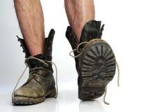 Παλαιές μπότες με τα πόδια Στοκ εικόνα με δικαίωμα ελεύθερης χρήσης