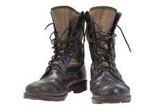 Παλαιές χρησιμοποιημένες μπότες ζουγκλών Στοκ Εικόνες