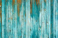 Παλαιές Shabby ξύλινες σανίδες με το ραγισμένο χρώμα χρώματος Στοκ Φωτογραφία