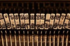 Παλαιοί απεργοί πιάτων γραφομηχανών με τις επιστολές και τα σύμβολα Στοκ Εικόνες