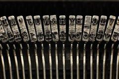Παλαιοί απεργοί πιάτων γραφομηχανών με τις επιστολές και τα σύμβολα Στοκ εικόνα με δικαίωμα ελεύθερης χρήσης