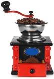 Παλαιός παλαιός ξύλινος μαύρος και κόκκινος μύλος καφέ, φασόλια καφέ Στοκ εικόνα με δικαίωμα ελεύθερης χρήσης
