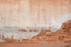 Παλαιός πορτοκαλής τοίχος φραγμών στοκ φωτογραφίες