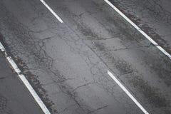 Παλαιός δρόμος άνωθεν - ραγισμένη οδός ασφάλτου Στοκ Εικόνες