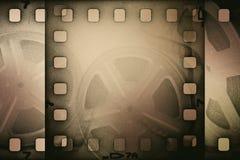 Παλαιό εξέλικτρο κινηματογραφικών ταινιών Grunge με τη λουρίδα ταινιών Στοκ Εικόνες
