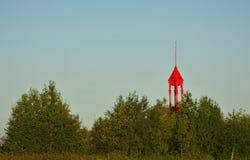 Παλαιό κόκκινο αναγνωριστικό σήμα σιδήρου Στοκ φωτογραφία με δικαίωμα ελεύθερης χρήσης