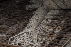 Παλαιό κλωστοϋφαντουργικό προϊόν σε μια περιστροφή Στοκ Εικόνα