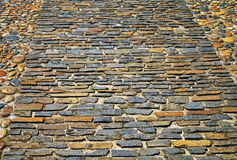 Παλαιό πεζοδρόμιο από τις χρωματισμένες πέτρες αφηρημένη σύσταση ανασκόπη&sigma Στοκ Εικόνα