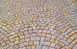 Παλαιό πεζοδρόμιο από τις χρωματισμένες πέτρες αφηρημένη σύσταση ανασκόπη&sigma Στοκ Εικόνες