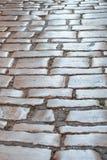 Παλαιό πεζοδρόμιο σχεδίων επίστρωσης πόλης πετρών στοκ εικόνες