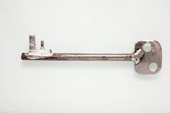 Παλαιό σκουριασμένο κλειδί στο λευκό Στοκ φωτογραφία με δικαίωμα ελεύθερης χρήσης