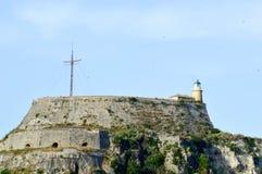 Παλαιό φρούριο στην Κέρκυρα και ένας σταυρός στην κορυφή Στοκ Εικόνες